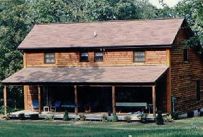 Scituate saltbox log home crockett log homes for Saltbox house plans with porch